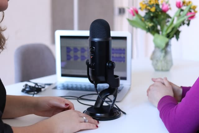 Importance of podcast transcripts; two people recording a podcast